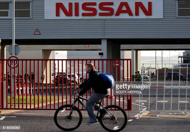 Workers leave the Nissan car plant after finishing their shift in Sunderland north east England on October 25 2016 Japanese car giant Nissan...