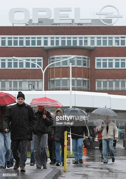 Workers leave the Opel Werk I factory of German automaker Opel after finishing the morning shift on March 10 2009 in Bochum Germany Opel owned by...