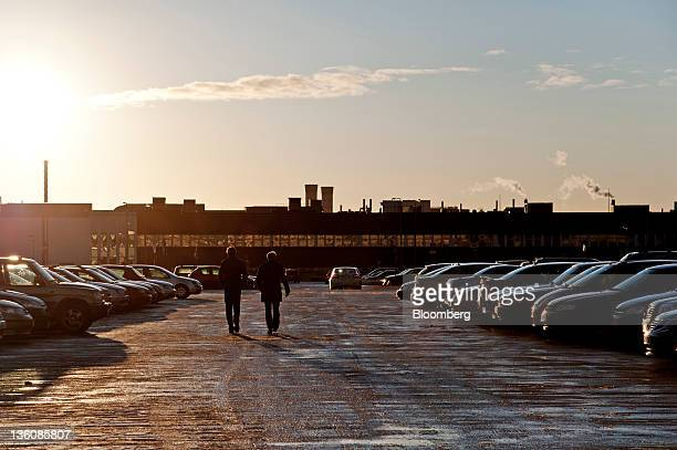 Workers leave the Saab Automobile factory through the car park after a meeting Victor Muller chief executive officer of Saab Automobile's parent...