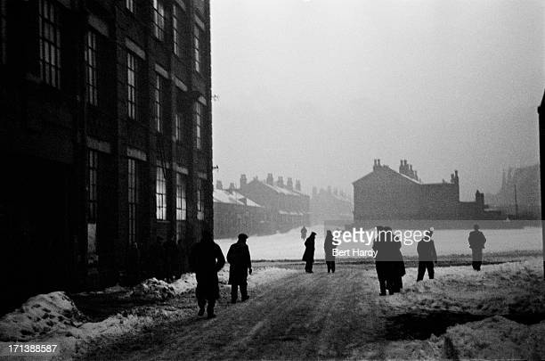 Workers leaving after a night shift at the Plume Street factory of the Hercules Cycle and Motor Company in Manor Mills Birmingham March 1947 Original...