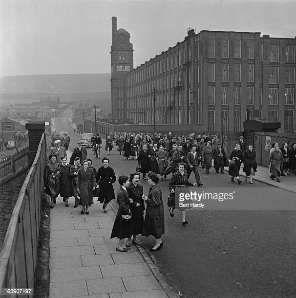 Workers leaving Rutland Mill a cotton spinning mill in Shaw Lancashire 15th March 1957 Original publication Picture Post 8859 The Truth About...