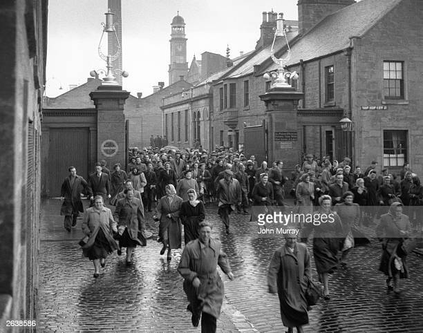 Workers leaving the Camperdown Mills in Dundee Original Publication Picture Post 7819 Dundee The Uncompromising pub 1955