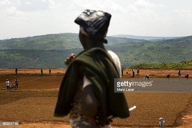 Workers level the land for the new football field on March 9 2009 inside the Agahozo Shalom Youth Village in Rwamagana Rwanda The ASYV provides food...