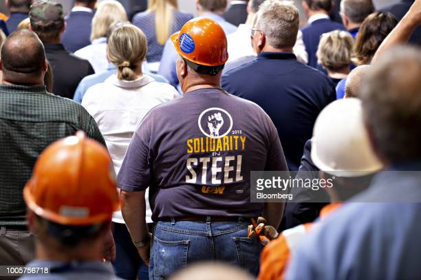 Workers listen as US President Donald Trump not pictured speaks at the US Steel Corp Granite City Works facility in Granite City Illinois US on...