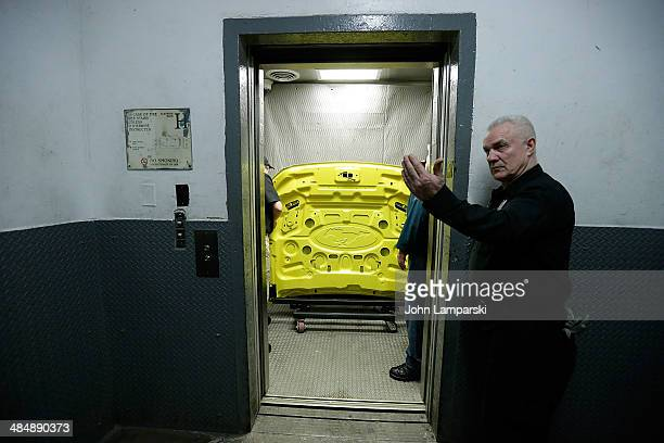 Workers load 2015 Ford Mustang components into the elevators in preparation for the 50th Anniversary of the Mustang At The Empire State Building at...