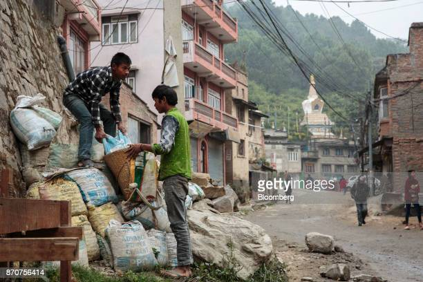 Workers load a bag of cement into a basket near the Swayambhunath Stupa in Kathmandu Nepal on Wednesday Nov 1 2017 India and China have often jostled...