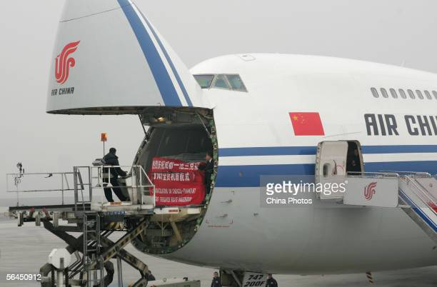 Workers load a Boeing 747200 freighter of Air China which is bound for Frankfurt at Chengdu Shuangliu International Airport December 18 2005 in...