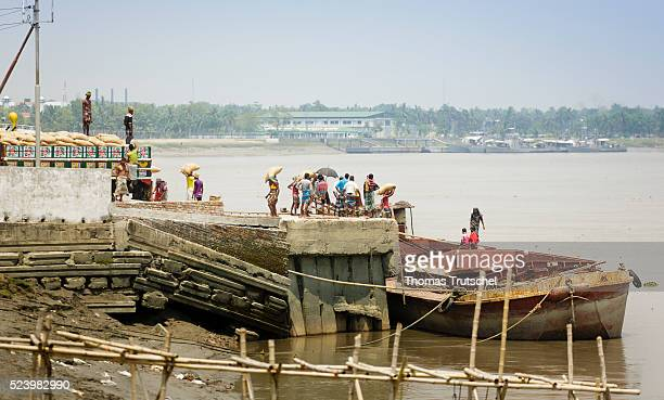 Workers load a ship in the port of Khulna on April 11 2016 in Khulna Bangladesh