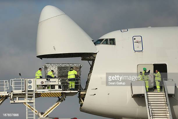 Workers load a shipment of aid from the German Red Cross and the THW technical emergence service destined for the Philippines on to a Boeing 747...