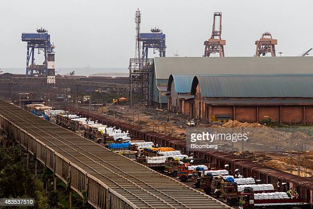 Workers load bags of urea fertilizer from trucks onto a freight train at the Kirshnapatnam Co port in Kirshnapatnam Andhra Pradesh India on Monday...