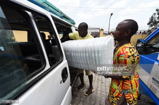 Workers load ballot boxes into a van at the Independent National Electoral Commission central office in Port Harcourt Rivers State on March 8 2019...
