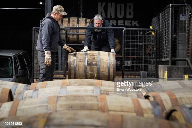 Workers load barrels of bourbon on to a truck at The Jim Beam Distillery on February 17, 2020 in Clermont, Kentucky. U.S. Whiskey exports have fallen...