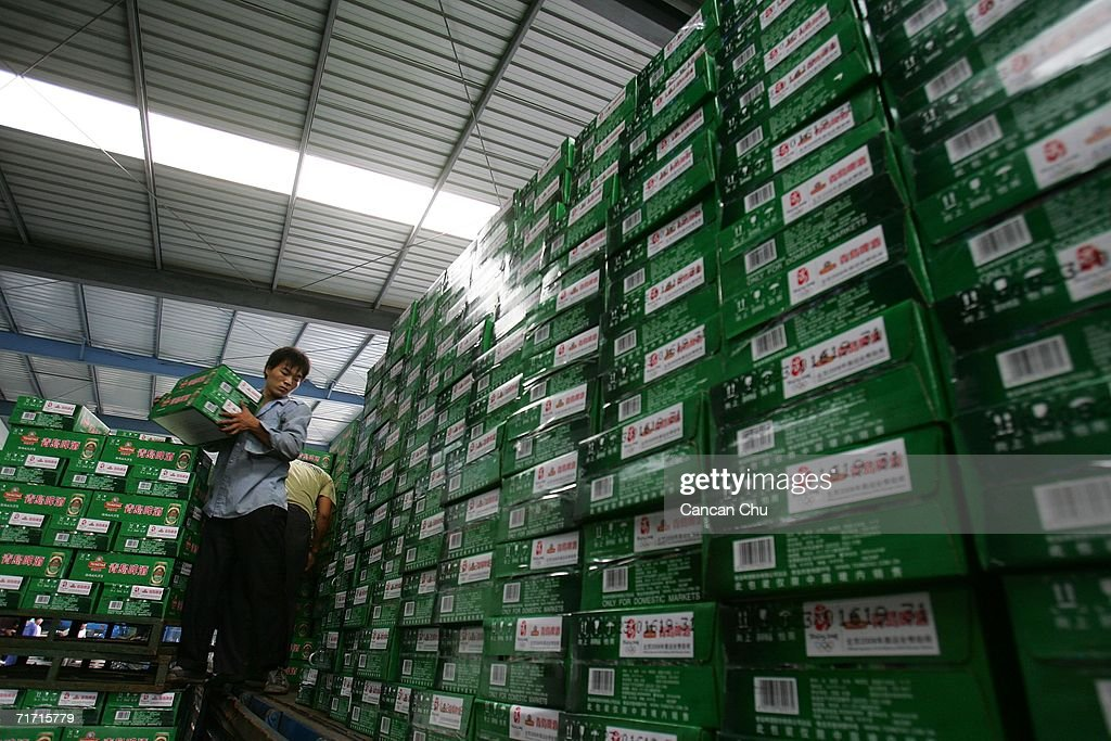 Workers load boxes of Tsingtao beer onto a truck at the Tsingtao beer factory on August 25, 2006 in Qingdao, Shandong Province of China. Tsingtao Beer Group, China's biggest beer brewery and the Official Domestic Beer Sponsor of the Beijing 2008 Olympic Games, hosts the 16th Qingdao International Beer Festival in Qingdao from August 12 to 26.