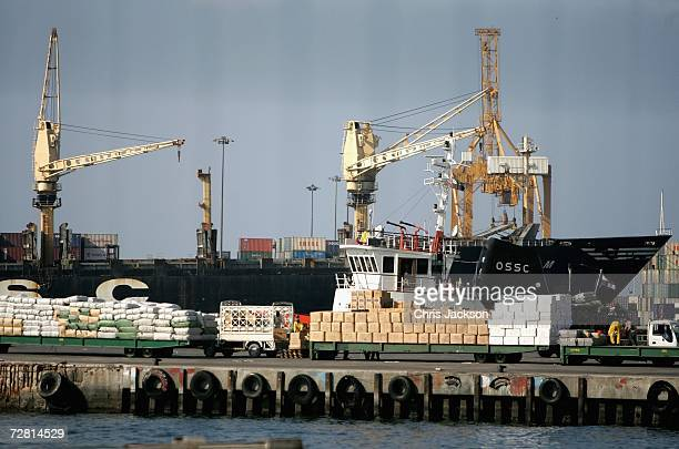 Workers load goods onto a cargo ship docked in Dubai Port on December 13 2006 in Dubai United Arab Emirates Import and export trades are flourishing...