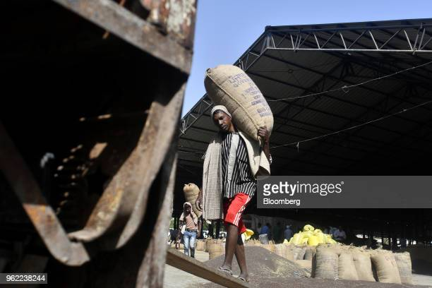 Workers load sacks of barley onto a truck at a wholesale grain market in Rewari Haryana India on Wednesday March 28 2018 India's Prime...
