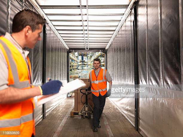 workers loading truck - loading dock stock pictures, royalty-free photos & images