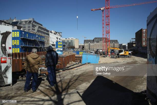 Workers look at a construction site that will reportedly include 34000 square meters of office space for German online fashion retailer Zalando at...