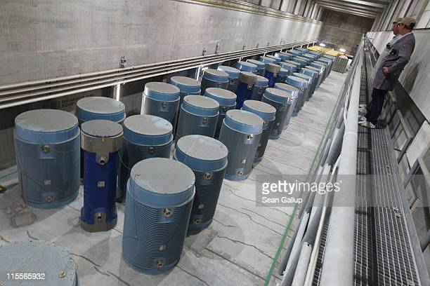 Workers look down at Castor containers filled with spent nuclear fuel rods from decomissioned nuclear power plants at the Zwischenlager Nord...