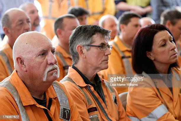 Workers look on as they wait for Australian Opposition Leader Tony Abbott to speak on September 3 2013 in Adelaide Australia In the 2010 election the...