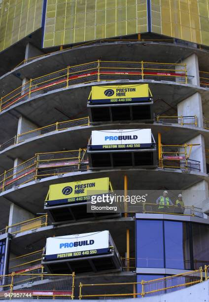 Workers look out from a construction site in the Elizabeth Quay area of Perth Australia on Wednesday April 11 2018 Australia is scheduled to release...