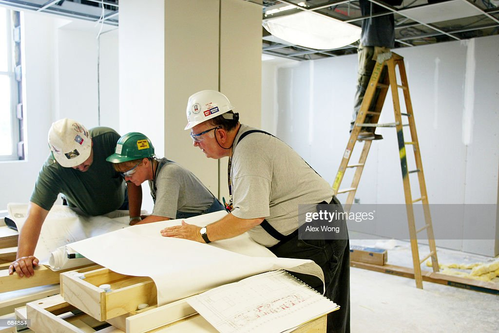 Pentagon renovation site pictures getty images workers look over blueprints june 10 2002 at the pentagon in washington dc malvernweather Choice Image
