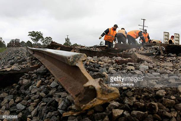Workers look to repair the tracks after the Melbournebound Pacific National train derailment late last night near Winton 197km north of Melbourne on...