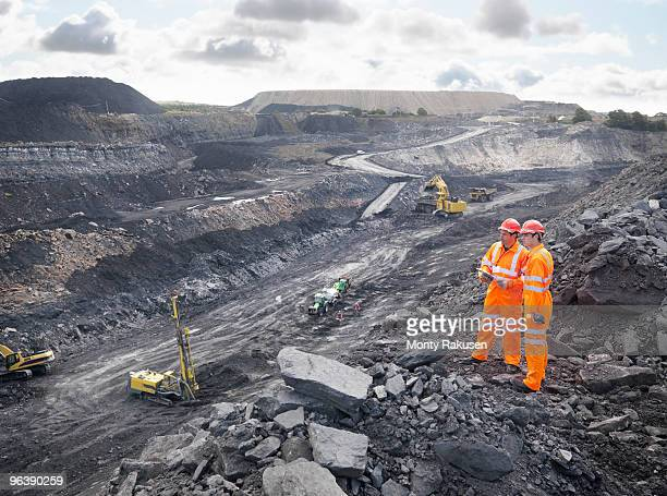 Workers Looking Over Coal Mine