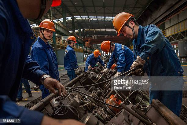 Workers maintain the production line at the Zhong Tian Steel Group Corporation on May 12, 2016 in Changzhou, Jiangsu. Zhong Tian Steel Group...