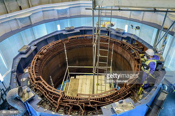 workers maintaining generator in hydroelectric power station - generator stock pictures, royalty-free photos & images