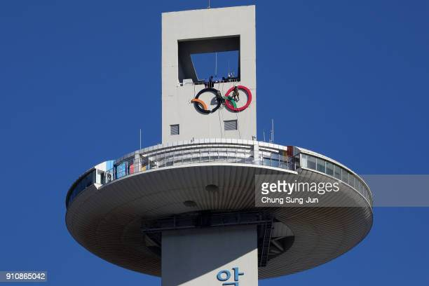 Workers make a Olympic Rings at the Alpensia Ski Jumping Centre ahead of PyeongChang 2018 Winter Olympic Games on January 27 2018 in Pyeongchanggun...