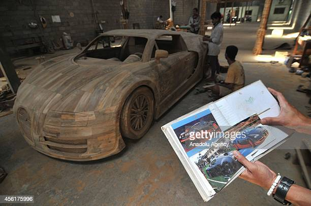 Workers make a realsize replica of Bugatti Veyron Super Sport car from wood in Boyolali Central Java Indonesia on September 26 2014 A replica of the...