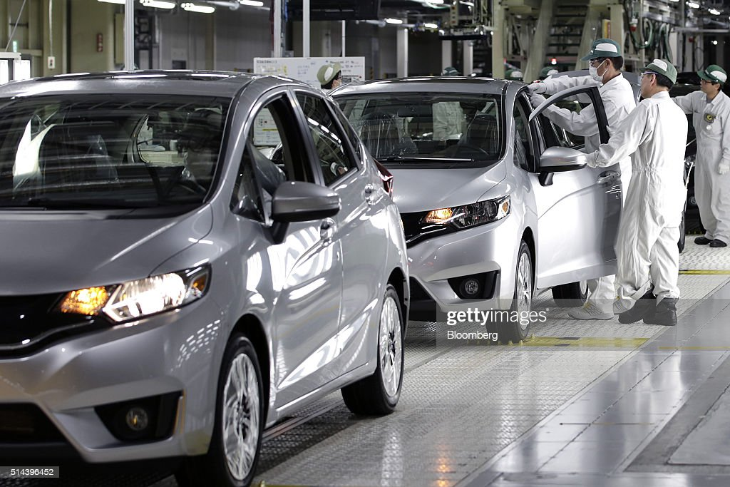 Workers Make Final Inspections To Honda Motor Co Fit Vehicles On The Production Line Of