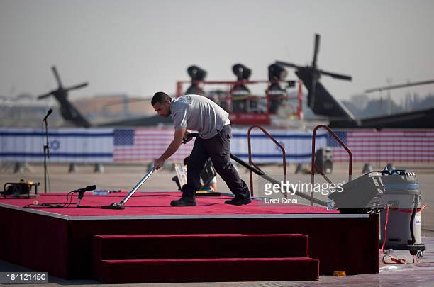 Workers make final preparations before an official welcoming ceremony for US President Barack Obama on his arrival at Ben Gurion Airport on March...