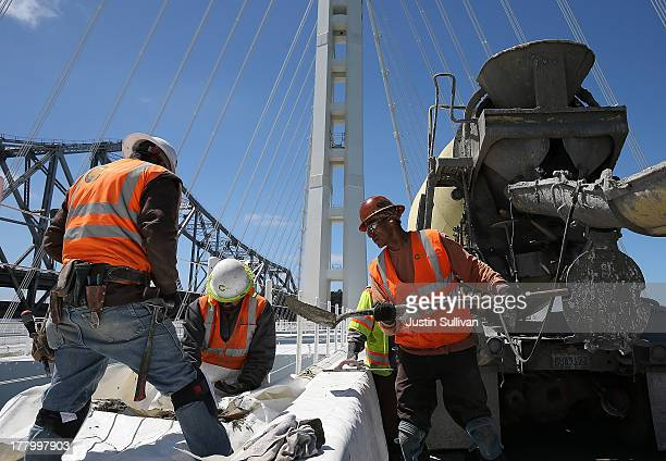 Workers make last minute reapairs on the eastern span of the new Bay Bridge on August 26 2013 in San Francisco California After nearly 12 years of...
