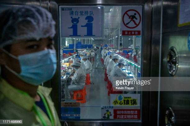 Workers make pods for the ecigarette company Mystlabs on the production line at First Union one of China's leading manufacturers of vaping products...