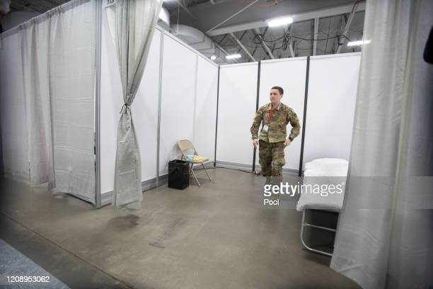 Workers make preparations at the Field Medical Station emergency field hospital at the Meadowlands Expo Center on April 2 2020 in in Secaucus New...