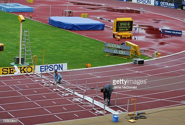Workers make preparations to the track prior to tomorrow's IAAF World Youth Athletics Championships at the City Stadium on July 10 2007 in Ostrava...