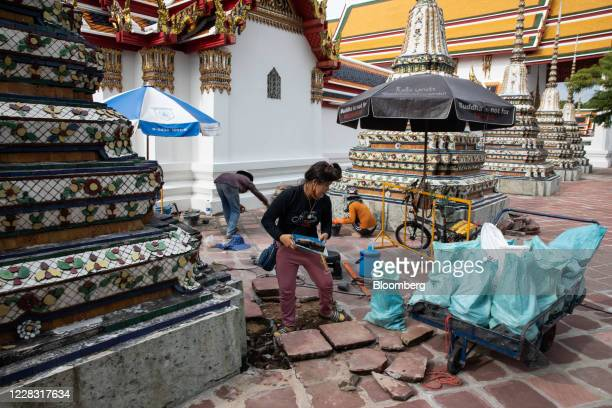 Workers make repairs at a nearempty Wat Pho in Bangkok Thailand on Wednesday Sept 2 2020 Thailand has reported zero locallytransmitted Covid19 cases...