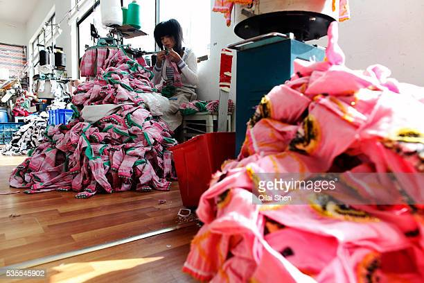 Workers make socks at the Shuangjin Knitting Textile Co in Zhuji Zhuji Province China on 01 November 2010 The rising cost of labor and raw materials...