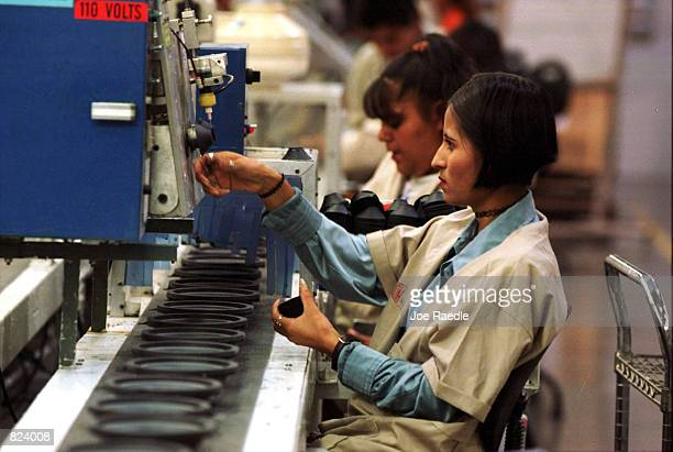 Workers make speakers in a maquila in Ciudad Juarez Mexico From Matamoros Mexico to Tijuana US owned maquiladoras employ a large work force