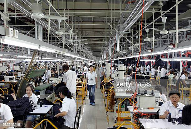 Workers make suits at a factory owned by the Baoxiniao Group on the outskirts of Shanghai China on 19 September 2010 Baoxiniao is the lasrgest suit...