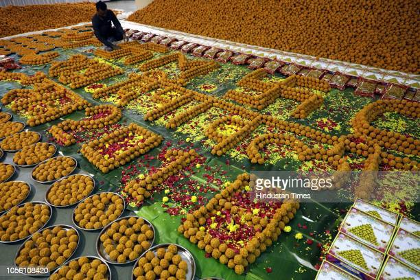 Workers make sweets Ladoo and Chivda at Poona Merchents Chambers ahead of Diwali Festival at Seven Love's Chowk Swargate on October 31 2018 in Pune...