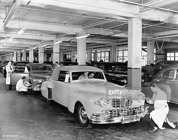 Workers make the final adjustments on 1946 Lincoln Continental Cabriolets along the assembly line