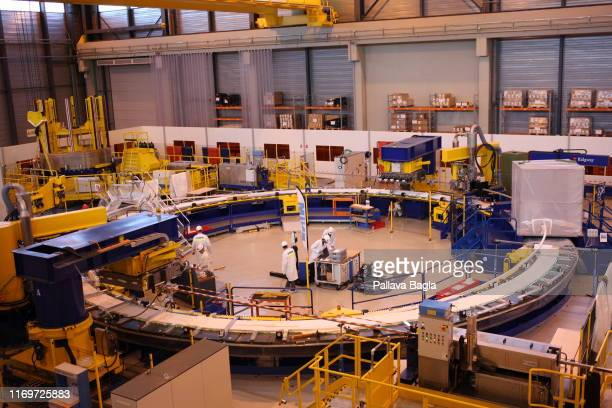 Workers make the Super Conducting magnets at an ITER facility which is part of a mega construction effort taking place in Southern France where...