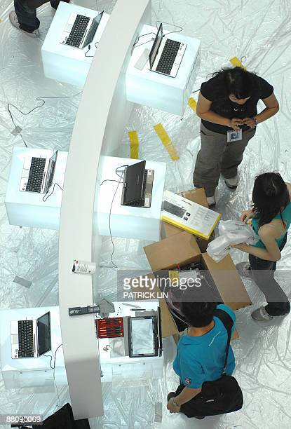 Workers make their last preparations for the Computex Taipei 2009 in the Taipei World Trade Centre on June 1, 2009. The information technology and...