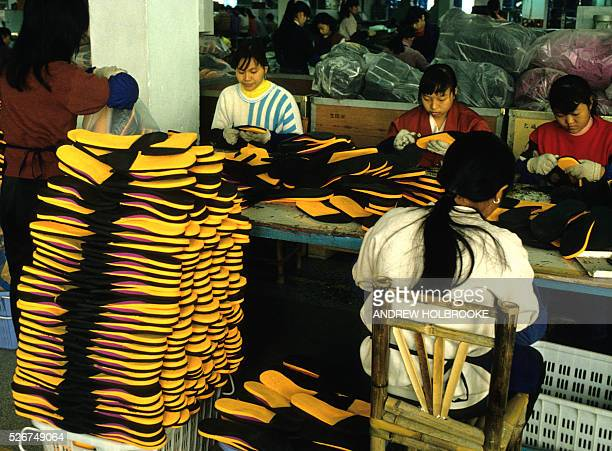 Workers making sneakers in a Nike factory Photo taken in March 1996