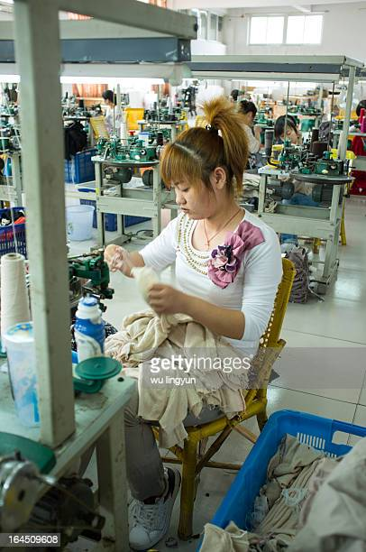 Workers making sweaters in China's sweater factory.