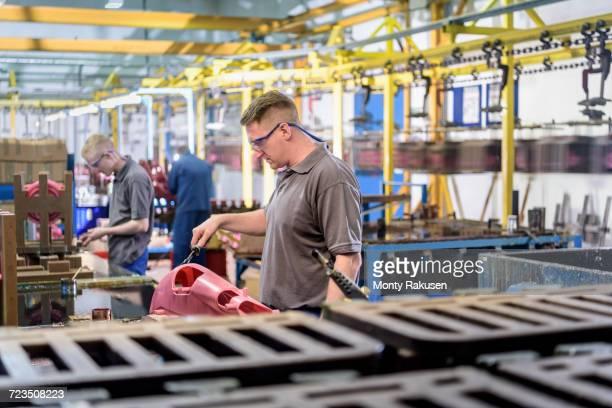 workers making wax components in precision casting factory - monty rakusen stock-fotos und bilder