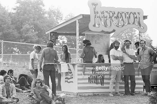 Workers man an information booth at the free Woodstock Music and Art Fair The festival took place on Max Yasgur's dairy farm which he rented to event...