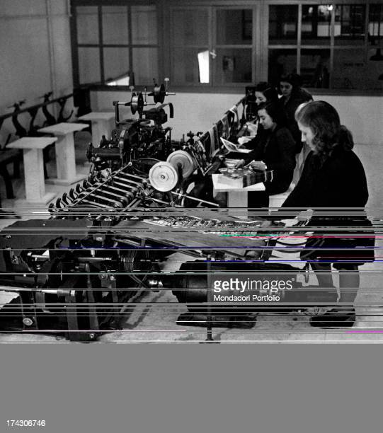 Workers manufacturing instalments using a rotogravure printing equipment at the Rizzoli printing factory Milan 1950s